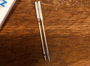 schmetz needle next to cheap needle