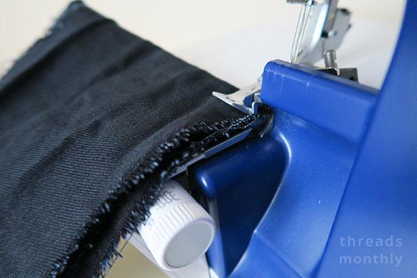 overlocking thick black denim fabric