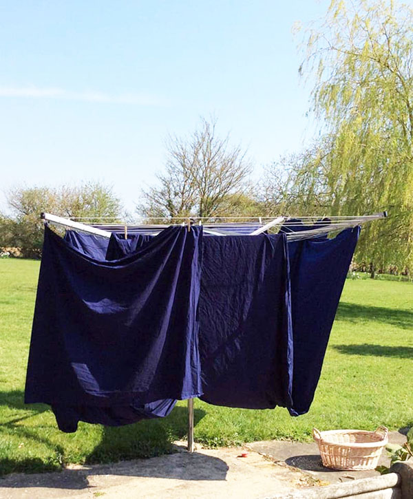 navy fabric for NHS scrubs on washing line