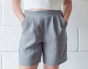 free shorts sewing pattern for women. This style has pleats, pockets, and an elastic back waist.