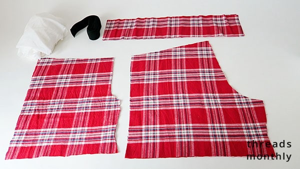 red plaid fabric cut out for pajama shorts