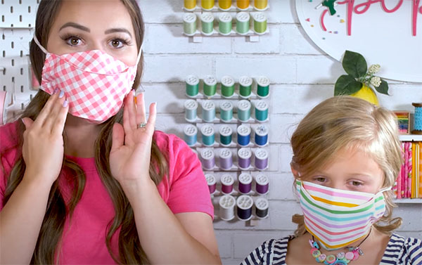 3d face mask worn by child and mother