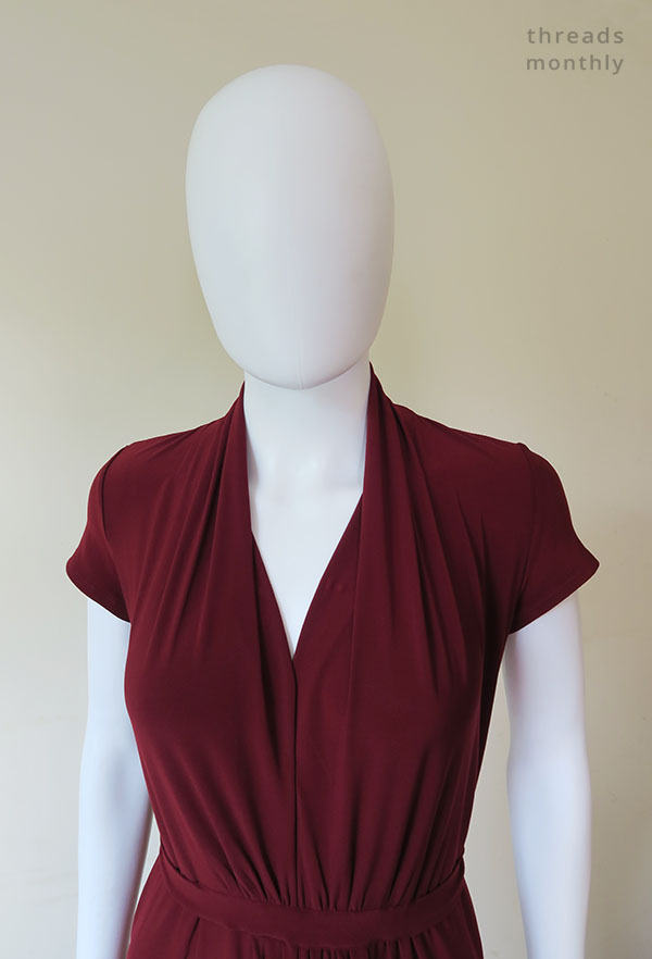 pleated v-neck of the Nina Lee Mayfair dress