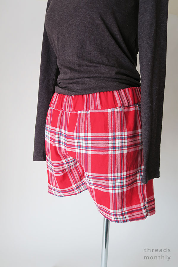 red pajama shorts and grey t-shirt worn by mannequin