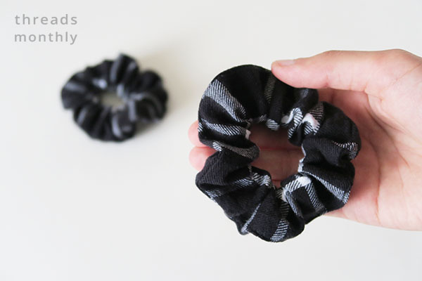 2 black and white plaid scrunchies