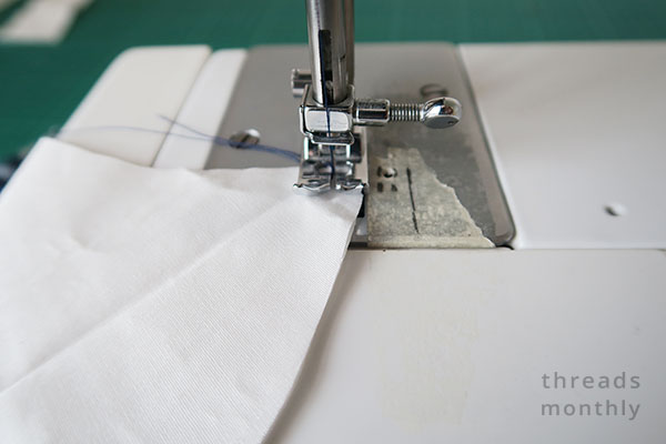 sewing a white face mask