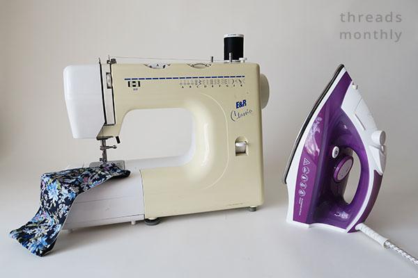 purple iron and cream sewing machine