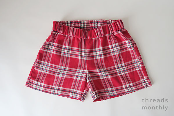 front view of red plaid pajama shorts