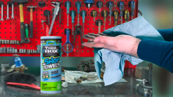 Toolbox blue shop towels being used to clean dirty hands