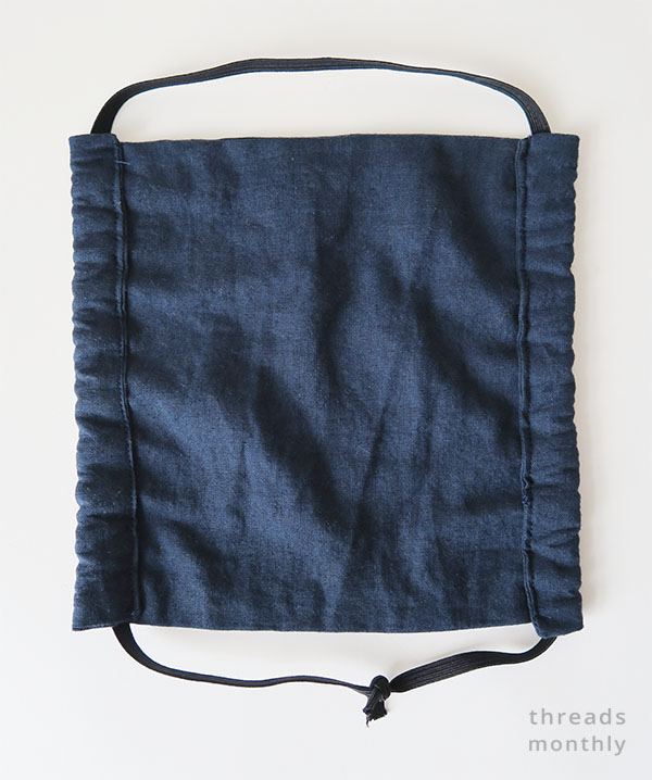 flat navy face mask with side channels