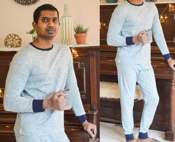 man wearing grey stretch pajama top and pants with contrasting cuffs
