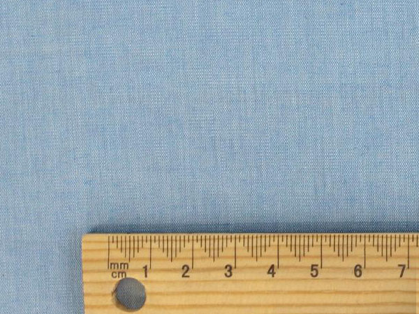 blue and white chambray cotton fabric with ruler