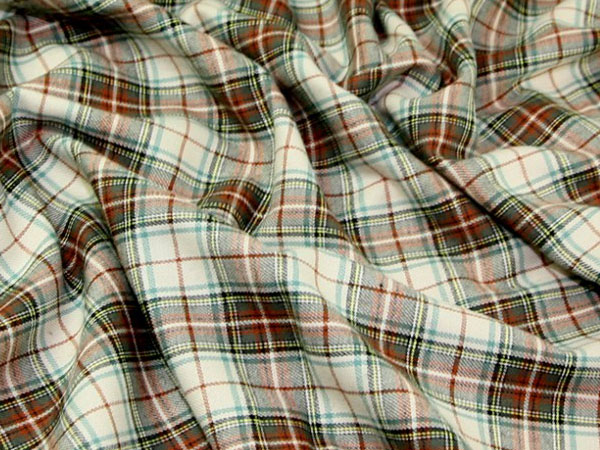 cream, brown and green plaid cotton flannel fabric