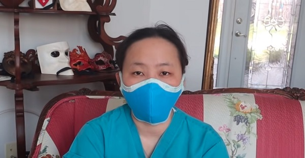 woman wearing a blue olson face mask by instructables