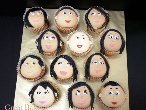cupcakes with peoples faces on them in icing