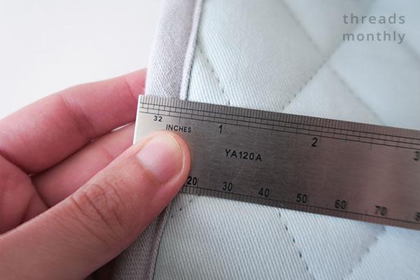 silver ruler measuring the bias binding edge
