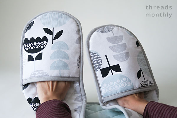 double oven gloves worn by person