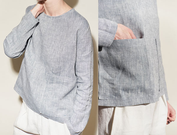 woman wearing grey long sleeve linen top with big patch pockets