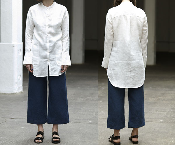 woman wearing long white button up shirt with pockets