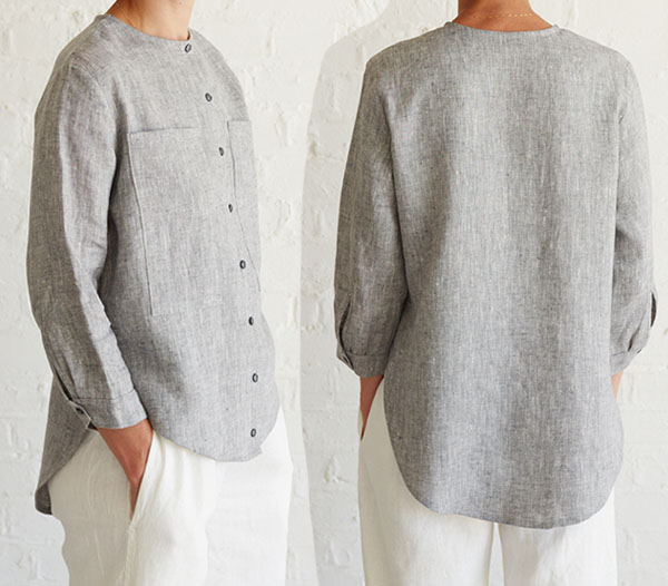 woman wearing grey collarless shirt with buttons and high-low hem