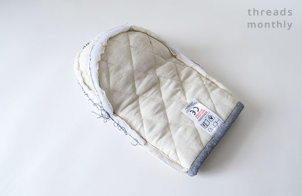 white cotton lining layer of oven mitt