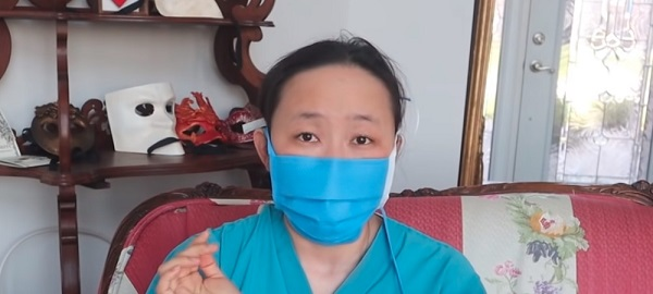 woman wearing a blue pleated face mask with ties