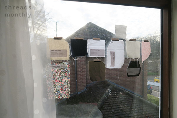 cotton fabric samples taped to window