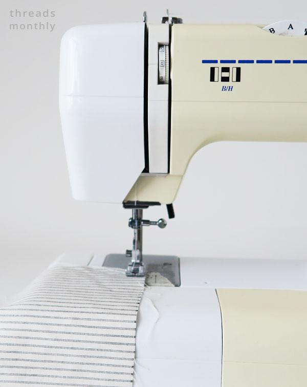 close up of sewing machine stitching fabric