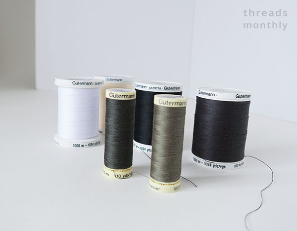 black, green and white gutermann sewing threads