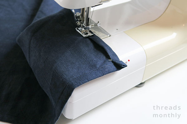 napkin edge being sewn on sewing machine