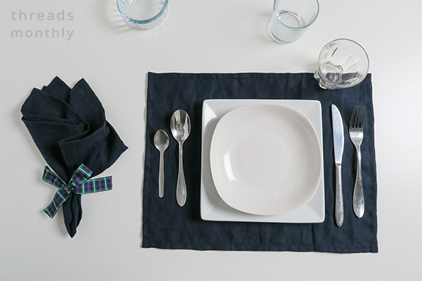 linen placemat and napkin with cutlery and plates