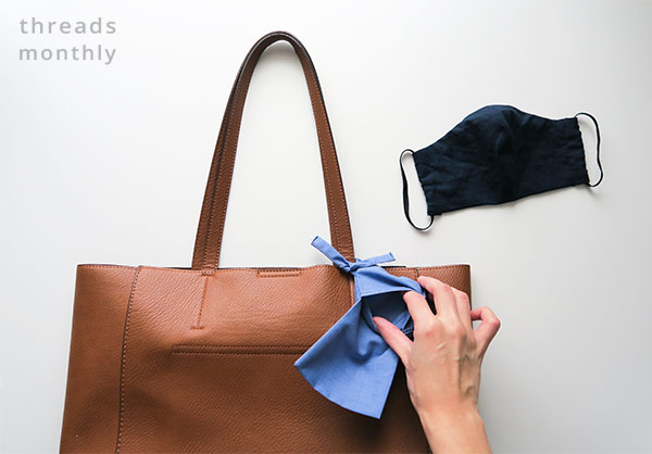 face mask pouch tied to a brown bag