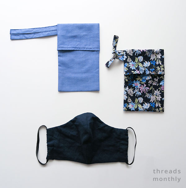 blue and floral face mask pouches next to a black face mask