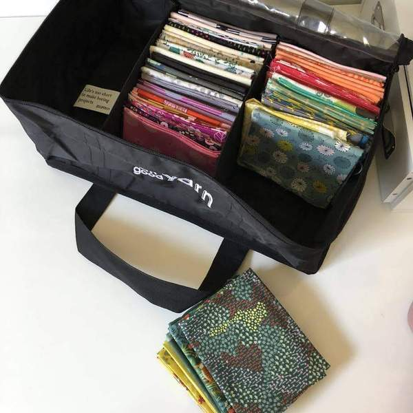 black bag with fat quarter fabrics stored inside