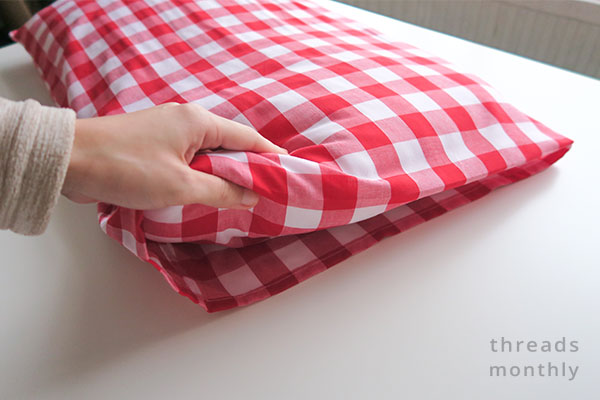 red homemade pillowcase with inner flap
