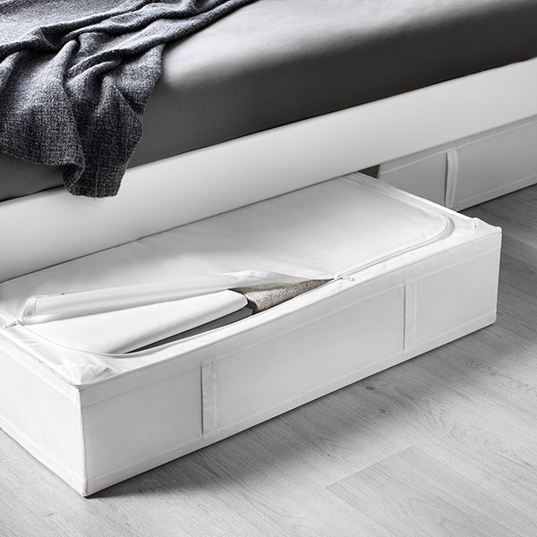 white fabric storage case under a bed