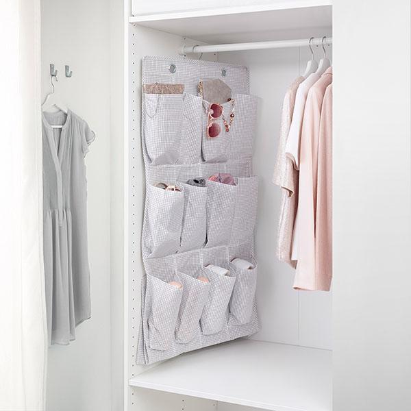 white hanging organizer inside a closet