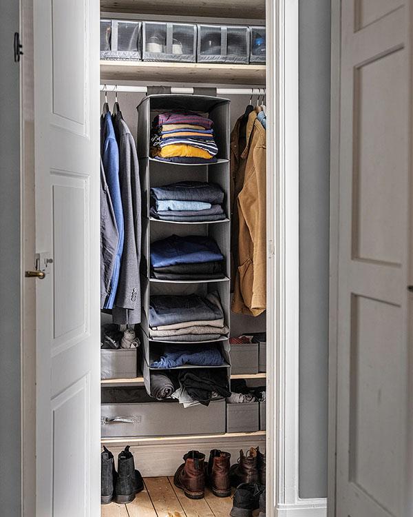 grey hanging organizer inside a closet