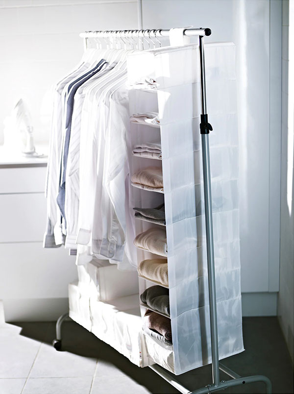 white hanging organizer on a clothing rail