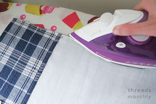 pillowcase being ironed