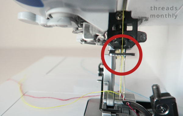 serger needle being threaded