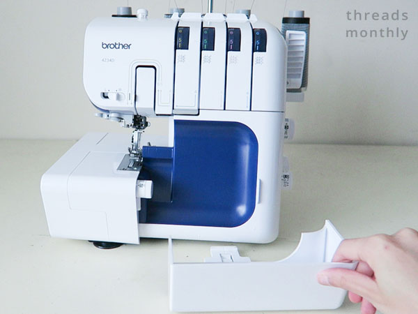 serger waste tray being attached