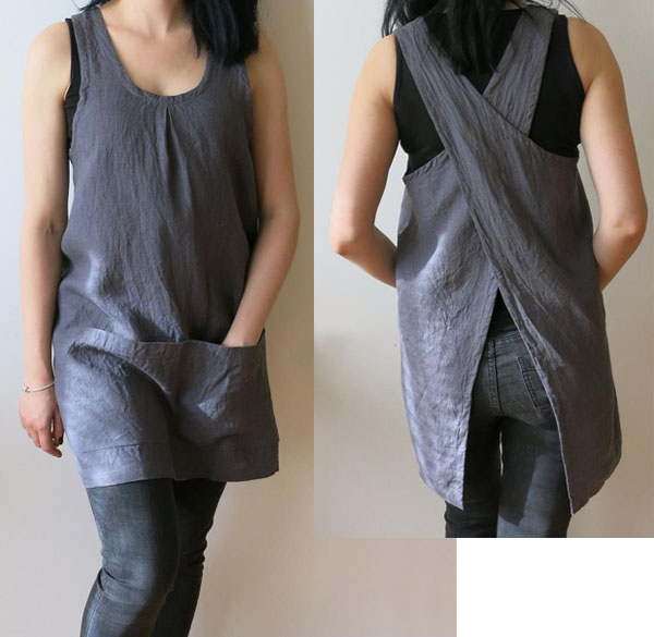 woman wearing grey linen apron with cross back