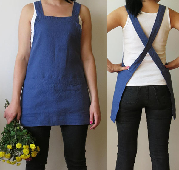woman wearing blue apron with cross back straps