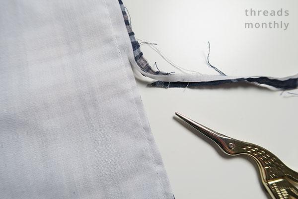 seam allowance being cut by small golden scissors