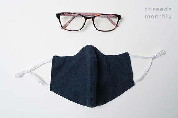 a curved face mask with glasses