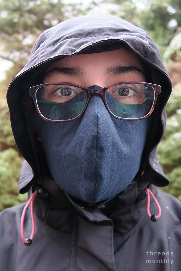 woman wearing a face mask with glasses