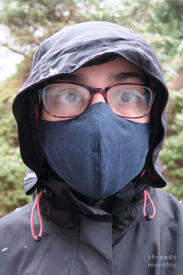 woman wearing olson face mask and her glasses fogging up