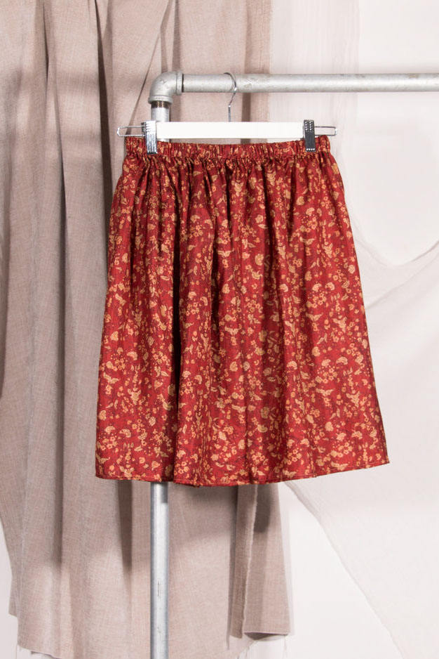 red printed skirt on a hanger