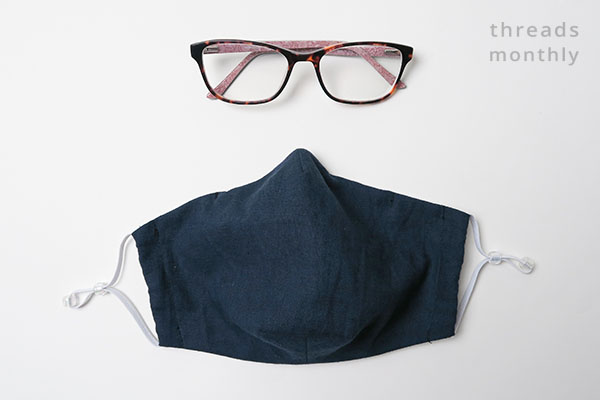 face mask with darts and a pair of glasses